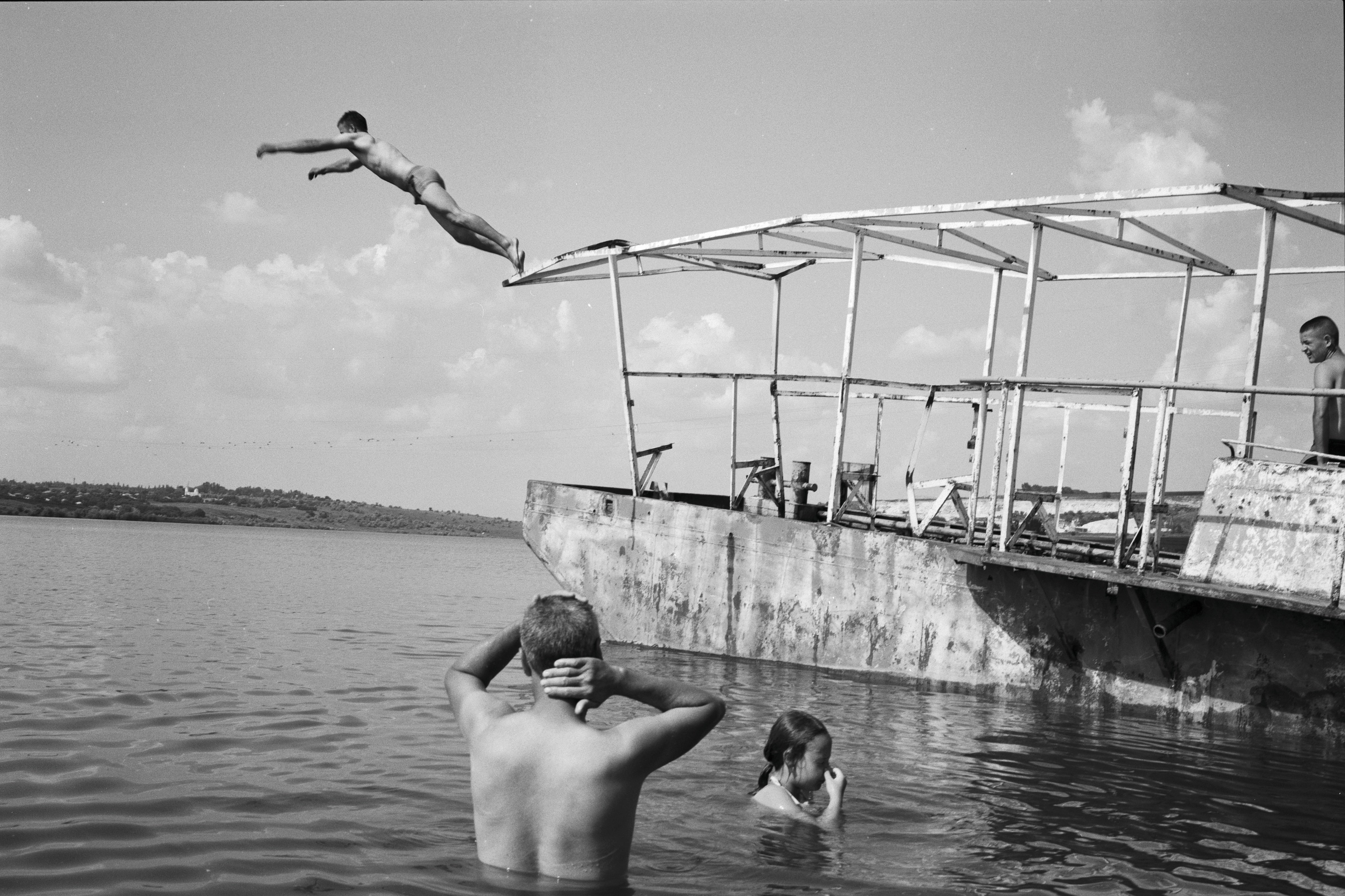 "Part of the ""Homeland"" project. Photo from a mini-series dedicated to the artificial Costești-Stânca dam, built in 1976, on the former Costești village. In the photograph, the derelict barge was used as a trampoline by many youngsters. Courtesy of Maria Guțu."